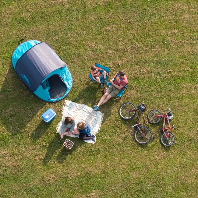 Aerial shot of Family camping at Forest Glade