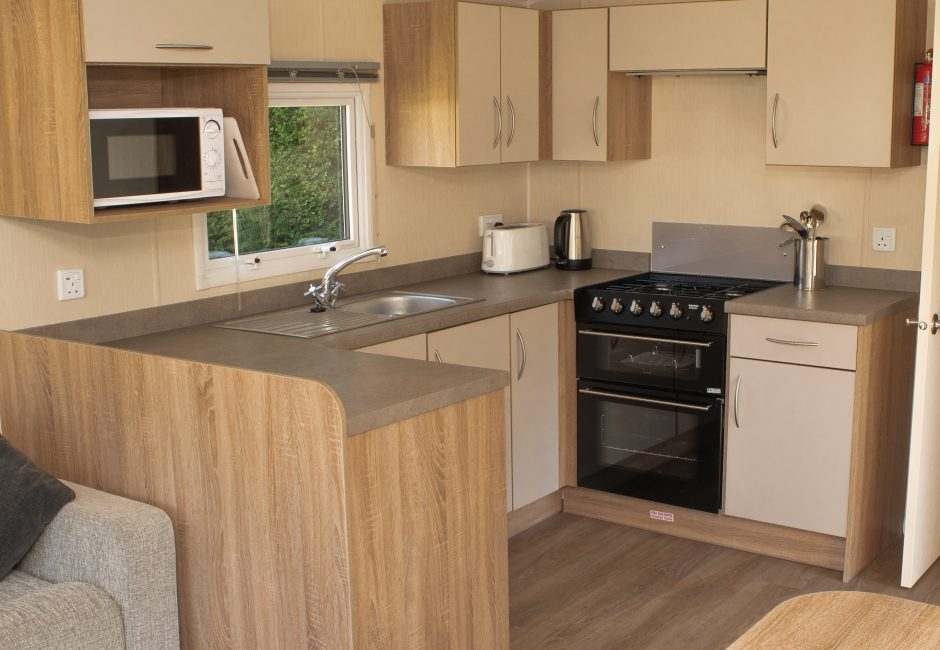 Exe Super Holiday Caravan Kitchen at Forest Glade