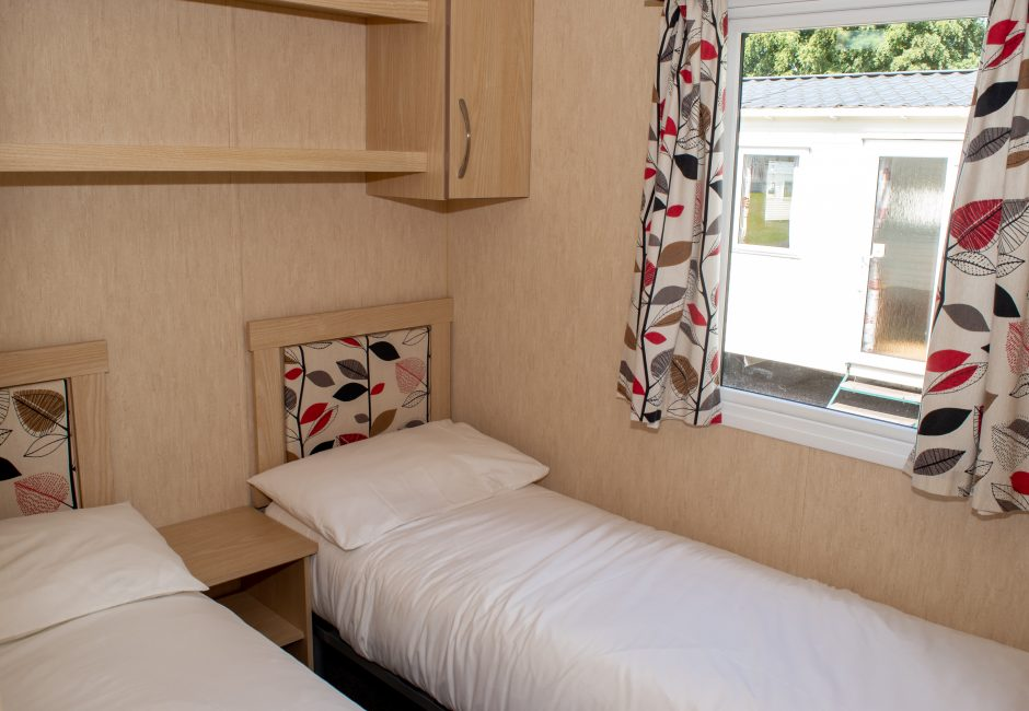 Otter holiday caravan devon at Forest Glade twin bedroom