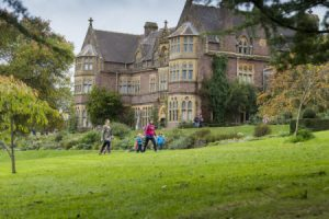 Visitors in the garden in autumn at Knightshayes